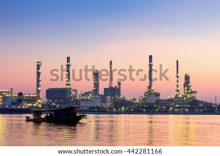 oil refinery industry plant along twilight morning ,  Chao Phraya Riverside ,Bangkok , Thailand