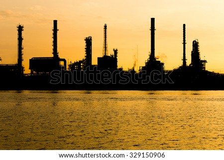 Oil refinery industry plant silhouette in the morning  - stock photo