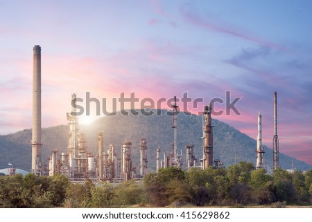 Oil refinery industry plant twilight at sunset