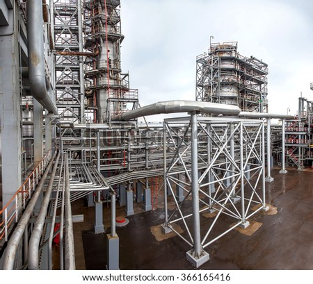 oil refinery on production of fuel, metal designs and structures of plant, a ladder for service of pipes, nobody.