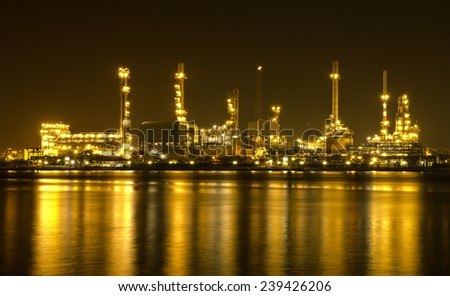 Oil refinery or petrochemical industry at dark for Logistic Import Export background - stock photo