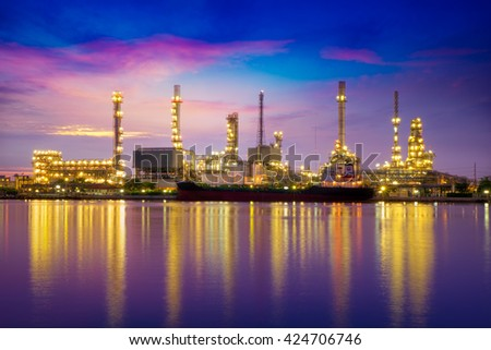Oil refinery or petrochemical industry with ship at twilight in thailand. for Logistic Import Export background