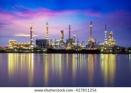 Oil refinery or petrochemical industry with ship at twilight in thailand. for Logistic Import Export background - stock photo