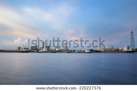 Oil refinery or petrochemical industry with ship in thailand.  - stock photo