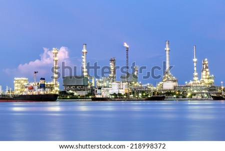 Oil refinery or petrochemical industry with ship in thailand.at dark for Logistic Import Export background - stock photo