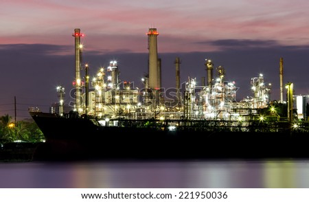 Oil refinery or petrochemical industry with ship in thailand.for Logistic Import Export background - stock photo