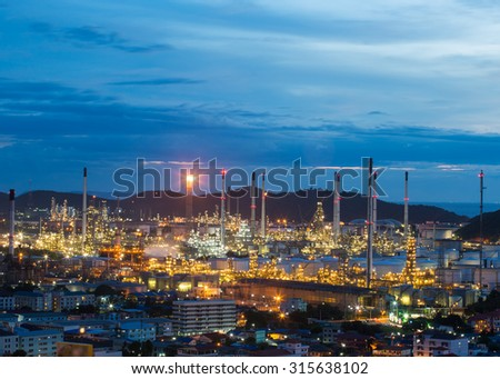 Oil refinery , Petrochemical industrial with city background at sunset , Bangkok , Thailand - stock photo