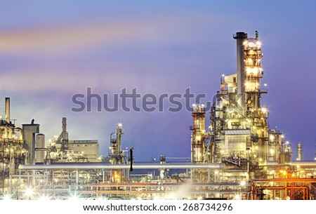 Oil refinery, petrochemical industry night scene - stock photo