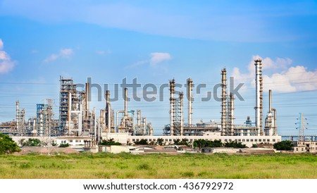 oil refinery plant against blue sky