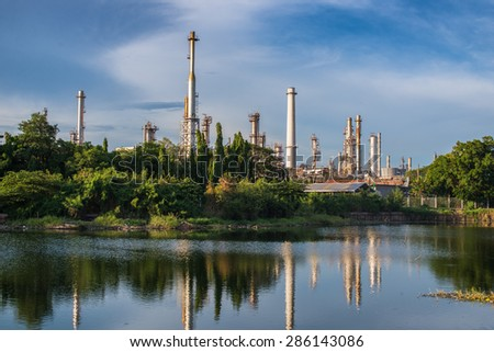 oil refinery plant and nature  - stock photo