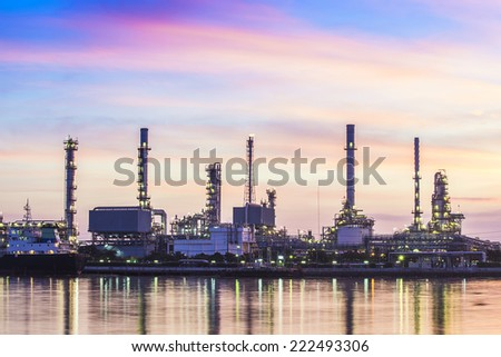 Oil refinery plant area at twilight - stock photo