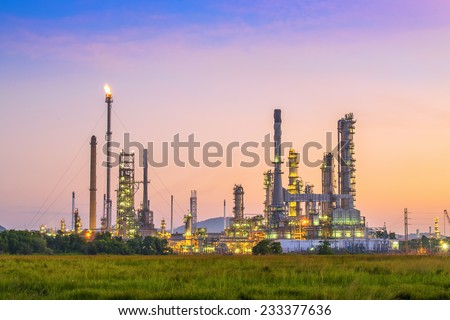 Oil refinery plant area at twilight - stock photo
