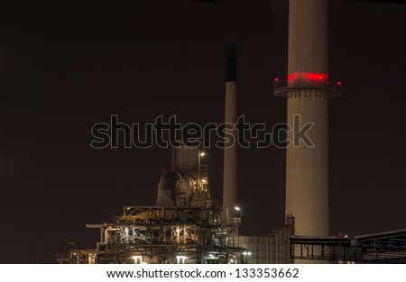 Oil refinery plant at dusk, power station - stock photo