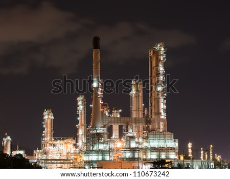 Oil refinery plant at night - stock photo