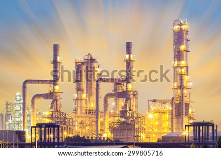 Oil refinery plant at twilight with sky background. - stock photo