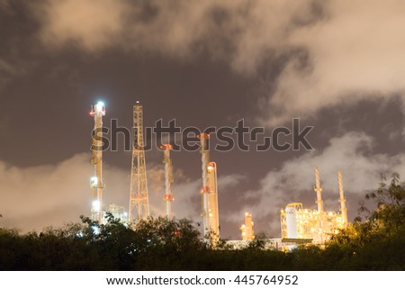Oil refinery plant of petroleum or petrochemical industry production at night