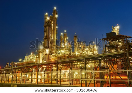 Oil refinery plant of petroleum or petrochemical industry production at sunset - stock photo
