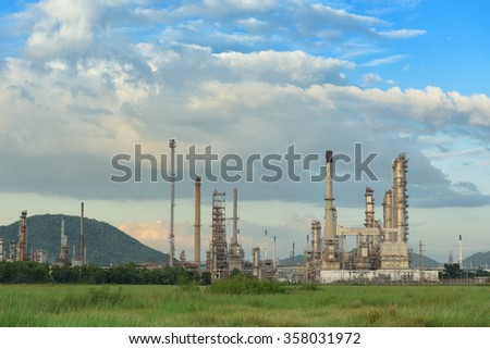 Oil refinery plant on cloudy and blue skies background