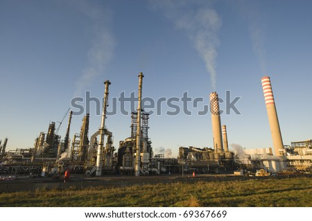 Oil refinery plant over blue sky - stock photo