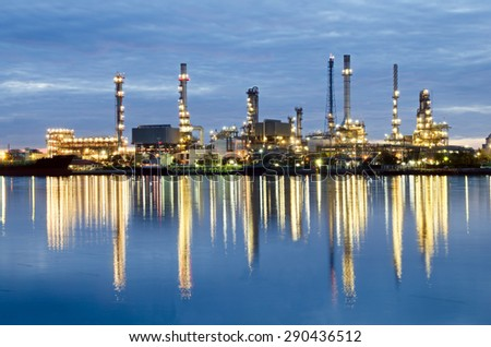 Oil refinery plant under sunrise sky