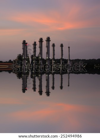 Oil Refinery reflected light water sunset industry in thailand . - stock photo