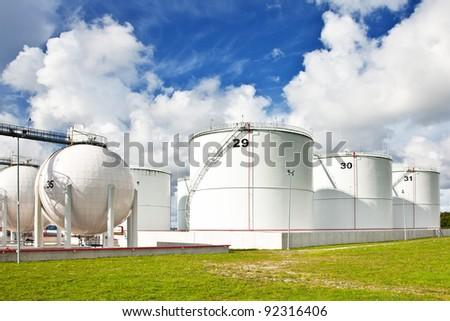 Oil refinery tanks - stock photo