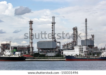Oil refinery with beautiful sky - stock photo