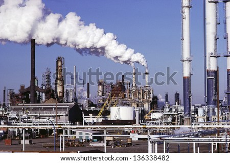 Oil refinery with blue sky in the background - stock photo