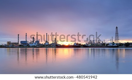 Oil refinery with riverside at dawn in Bangkok, Thailand