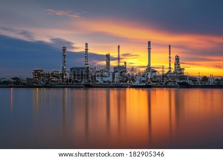 Oil refinery with sunrise background - stock photo