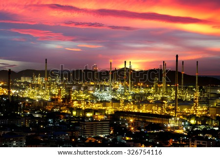 Oil refinery with tube and oil tank along twilight sky - stock photo