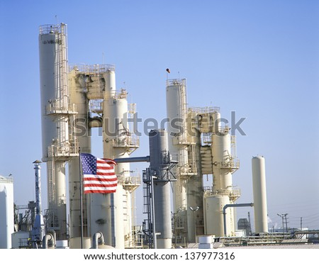 Oil refinery with US flag in the foreground