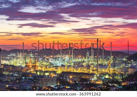 Oil refinery with water vapor in Hamburg, Germany, petrochemical industry during twilight. - stock photo