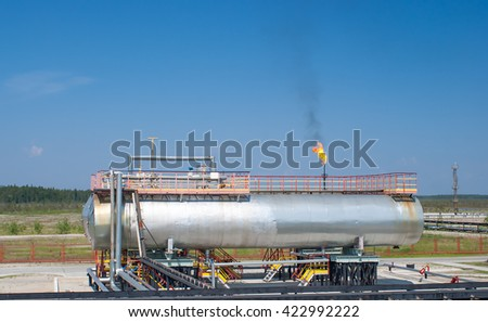 Oil reservoir on a background of blue sky - stock photo