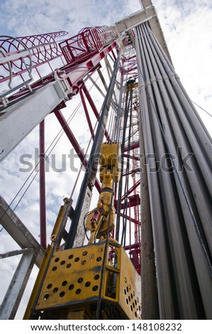 Oil rig and drilling pipes - stock photo