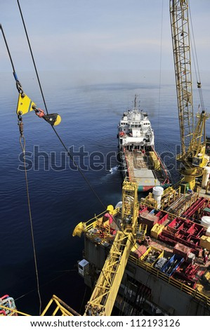 Oil Rig and Moored Loading Ship - stock photo
