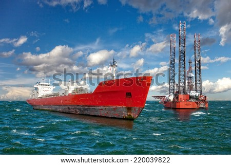Oil rig and tanker ship on offshore area.  - stock photo