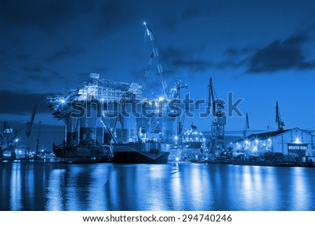 Oil Rig at night in Shipyard - industry concept. - stock photo
