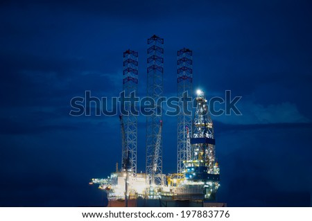 Oil rig at sea in night. - stock photo