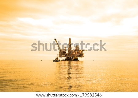 Oil Rig during sunset hours - stock photo