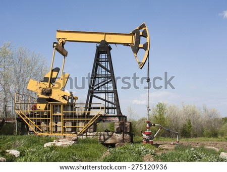 Oil rig for getting yellow. Pumping oil from the earth. Oil derrick. pumping oil. oil equipment. - stock photo