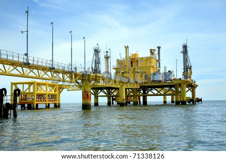oil rig in offshore area - stock photo