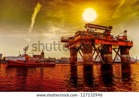 Oil rig in the dramatic scenery. - stock photo