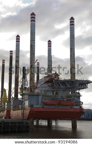 oil rig in the harbor - stock photo