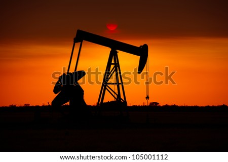 Oil Rig in West Texas during Sunset - stock photo