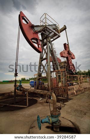 Oil rig pump closeup low angle view - stock photo
