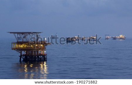 Oil rigs in an open sea - stock photo