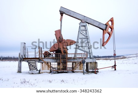 oil rocking chair in winter - stock photo
