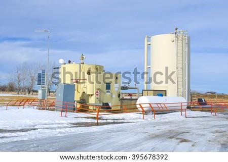 Oil separator on the prairie of Alberta - stock photo