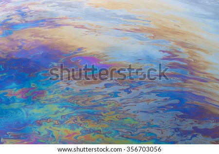 oil slick on the water - stock photo